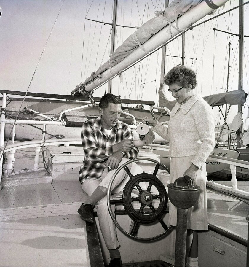 """December 17, 1966 -- """"Muff"""" and Malcolm Graham Jr. sipping coffee here in happier days after returning from an around-the-world sail aboard Sea Wind that took five years and eight months. U-T San Diego file photo..San Diego History Center /Union-Tribune collection"""