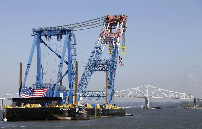 A large crane named the Left Coast Lifter arrives at the Tappan Zee Bridge near Nyack, N.Y., Monday, Oct. 6, 2014. The crane, which can lift 1900 tons, will assist in the ongoing construction at the bridge. (AP Photo/Seth Wenig)
