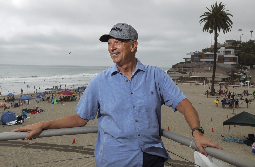 "San Diego author Robert Pacilio is photographed at Moonlight Beach in Encinitas. Both the beach and the town play major roles in ""Meet Me at Moonlight Beach,"" Pacilio's novel about love, hope and second chances. He will be reading from his book at Bliss 101 in Encinitas on Thursday, July 25."