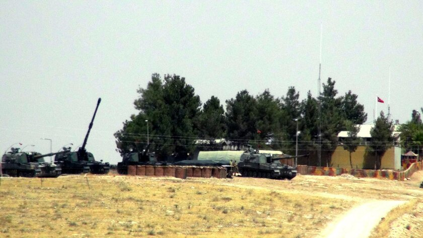 Turkish tanks stationed near the Syrian border in Karkamis, Turkey, Wednesday, Aug. 24, 2016. Turkey's military launched an operation before dawn Wednesday aimed at clearing a Syrian border town from Islamic State militants, and a private Turkish TV station reported that a small number of Turkish s
