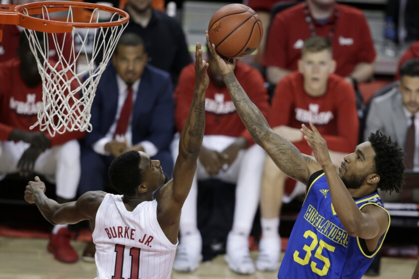 UC Riverside's George Willborn III (35) goes for a layup against Nebraska's Dachon Burke Jr. (11) during the first half on Tuesday Lincoln, Neb.