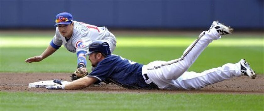 Chicago Cubs' Darwin Barney, left, just misses the tag on Milwaukee Brewers' Mark Kotsay who slides into second on a double during the first inning of a baseball game on Sunday, April 10, 2011, in Milwaukee. (AP Photo/Jim Prisching)