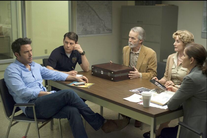 "Ben Affleck, left, Patrick Fugit, David Clennon, Lisa Barnes and Kim Dickens in a scene from ""Gone Girl."""
