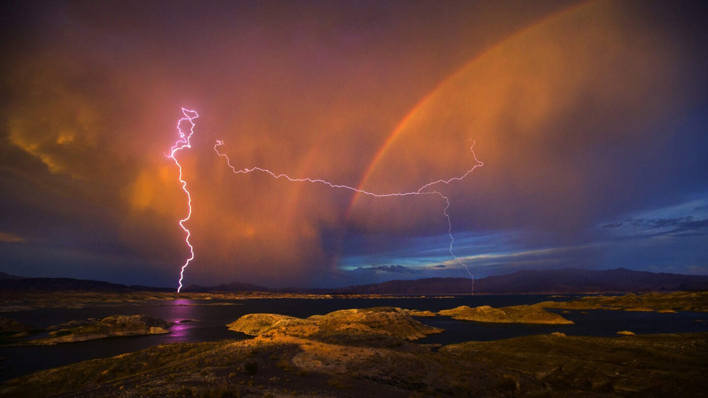 Lightning and a rainbow form over Lake Mead National Recreation Area in Nevada. Lake Mead is at a historic low due to the ongoing drought.