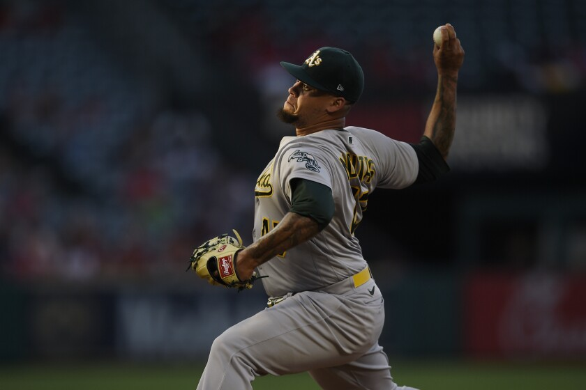 Oakland Athletics starting pitcher Frankie Montas throws during the second inning of the team's baseball game against the Los Angeles Angels in Anaheim, Calif., Thursday, July 29, 2021. (AP Photo/Kelvin Kuo)