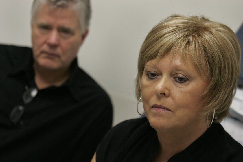 Jim Garlow, left, lead pastor at Skyline Church in Rancho San Diego, and his wife, Carol Garlow, right, talk with her oncologist at Sharp Hospital in Kearny Mesa.