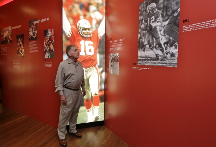 Retired San Francisco 49ers General Manager John McVay looks at photos at the Preview Center in Sant