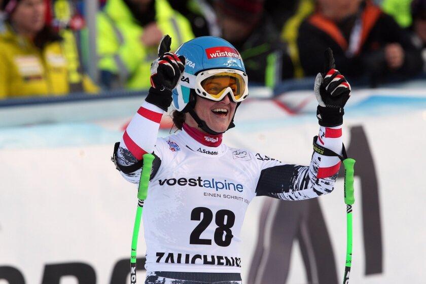 Austria's Elisabeth Goergl celebrates after winning an alpine ski World Cup women's downhill, in Altenmarkt Zauchensee, Austria, Saturday, Jan. 11 , 2013. (AP Photo/Enrico Schiavi)