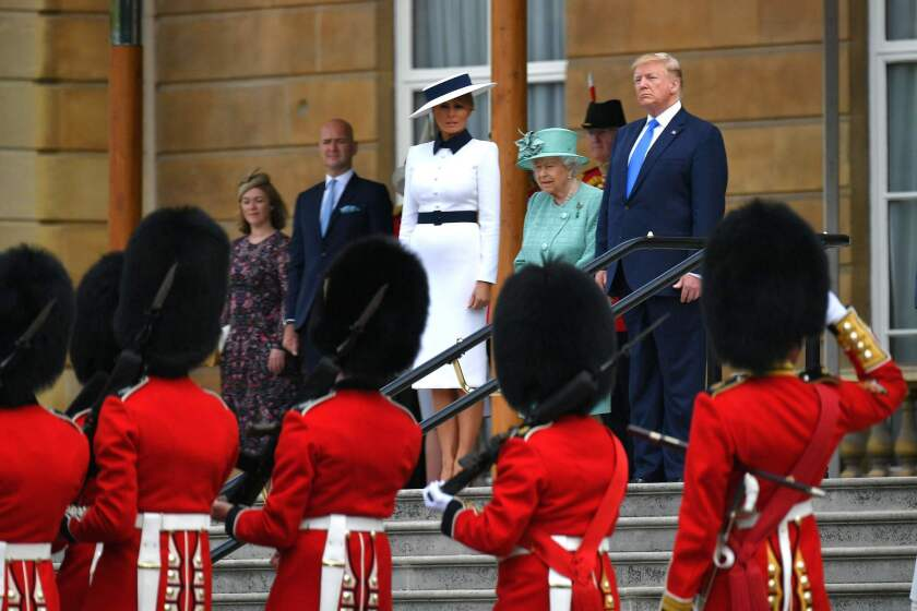 First Lady Melania Trump, Britain's Queen Elizabeth II and President Trump watch an honor guard during a welcome ceremony at Buckingham Palace on June 3, 2019.