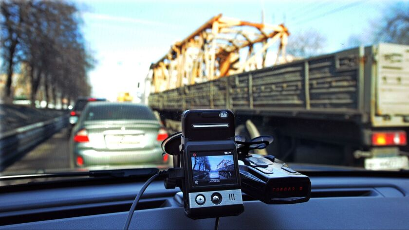 This file photo taken on March 13, 2013, shows a mini camera with a screen placed on a dashboard of a car rolling along a street in Moscow.