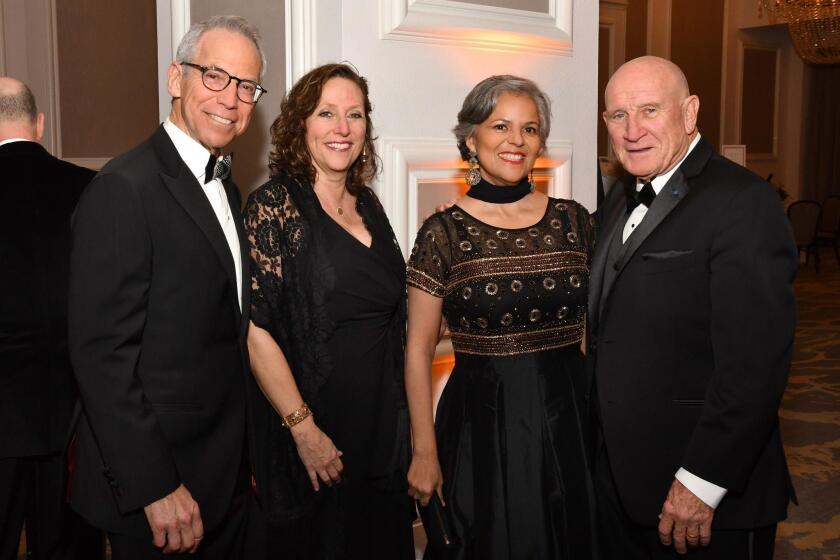 Don and Stacy Rosenberg (she's SDO board member), Andrea Puente Catan (SDO major gift officer), Peter Farrell