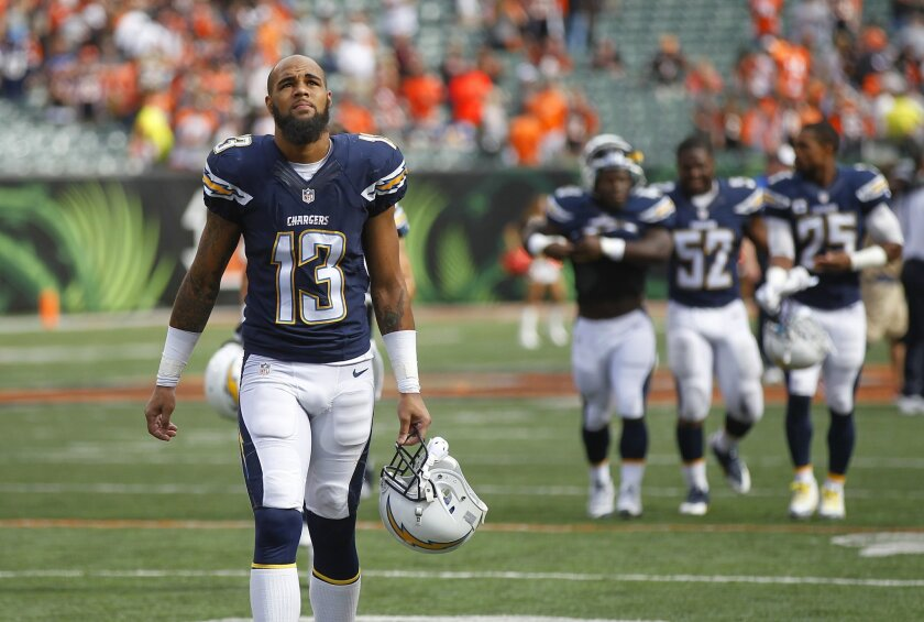 Chargers Keenan Allen walks of the field after a 24-19 loss to the Bengals.