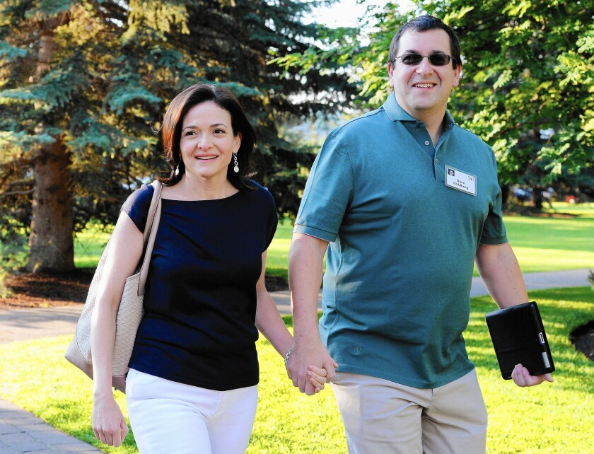 Sheryl Sandberg and husband David Goldberg attend the Allen & Co. conference in Sun Valley, Idaho, in July 2013.