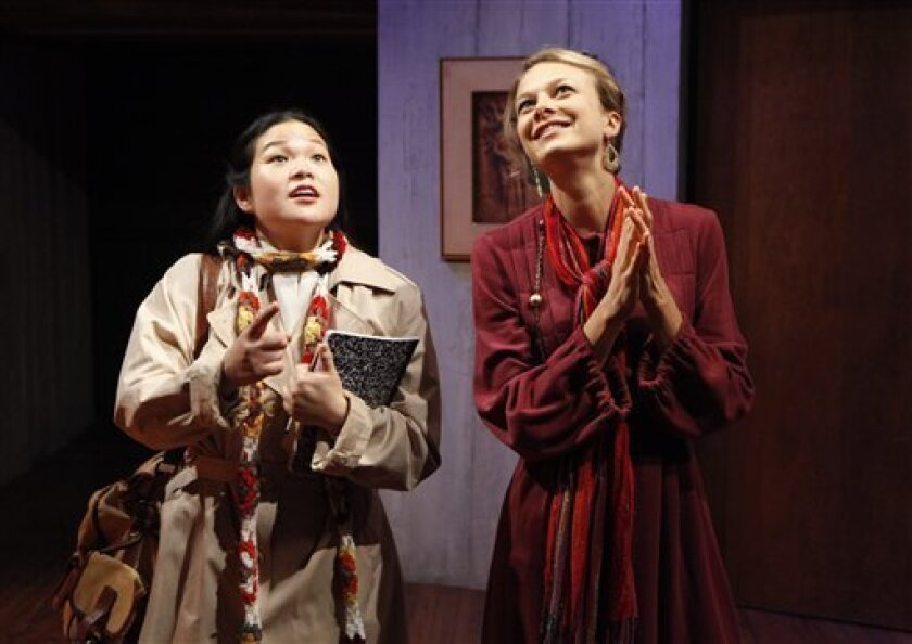 "In this publicity photo released by Spin Cycle, Holly Chou, left, and Maren Langdon are shown in a scene from A.R. Gurney's ""Office Hours,"" premiering at off-off-Broadway's Flea Theater in New York. (AP Photo/Spin Cycle, Richard Termine)"