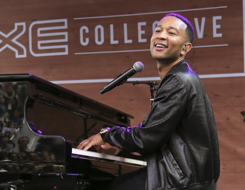 FILE - In this March 17, 2016, file photo, John Legend performs during the South by Southwest Music Festival in Austin, Texas. Legend will perform the national anthem for Game 1 of the NBA Finals between the Golden State Warriors and the Cleveland Cavaliers on Thursday, June 2, 2016. (Photo by Jack