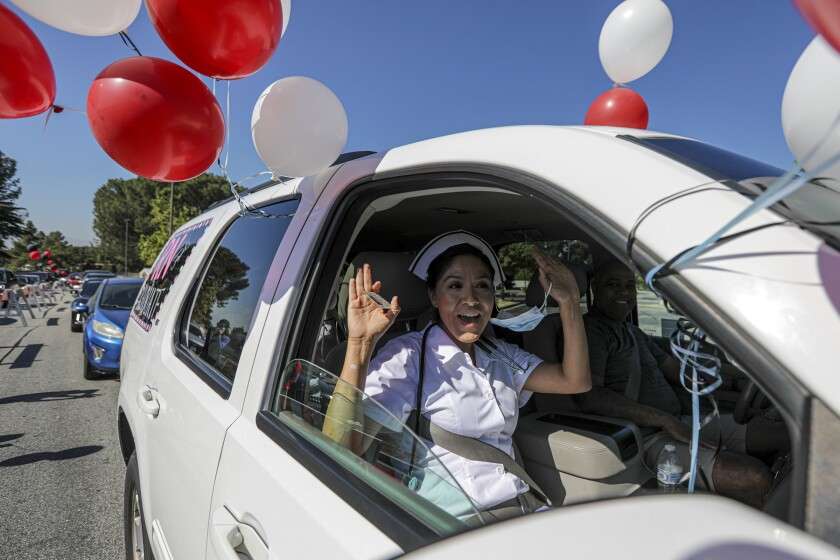 Chaffey College student Jessica Reyes at a drive-through graduation ceremony