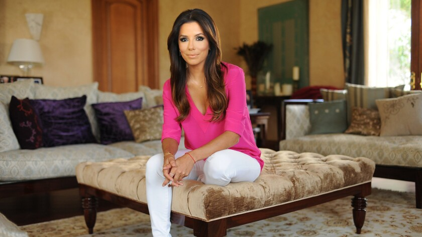 Eva Longoria, pictured at her home, has sold her compound in the Hollywood Hills for $8.25 million. The 2.75-acre estate was previously owned by Tom Cruise.