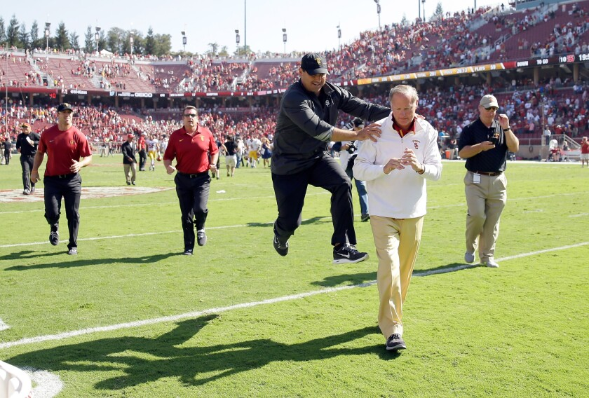 USC Coach Steve Sarkisian jumps in celebration next to Athletic Director Pat Haden after the Trojans beat Stanford on Sept. 6 in Palo Alto.