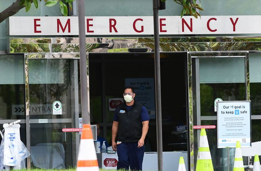 A healthcare worker wears a face mask at UCLA Emergency on March 24, 2020, in Los Angeles.