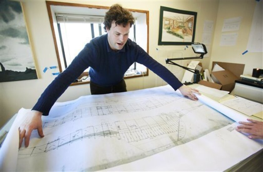 In this photo taken on Jan. 20, 2010, yachtsman and graphic designer Will Sofrin displays a drawing in his workshop at the Newport Shipyard, in Newport, R.I. Sofrin is using records owned by The Massachusetts Institute of Technology to create prints in 2010 of two dozen of Nathanael Greene Herreshoff's most heralded yacht designs. (AP Photo/Steven Senne)