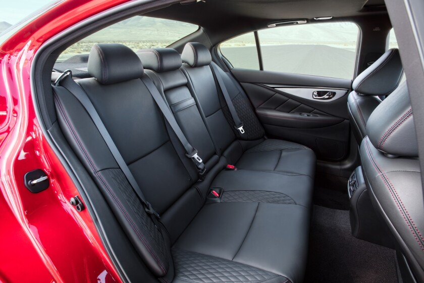 Back seat thigh support is as long as that in a large luxury liner, but legroom is compact at 35.1 inches.