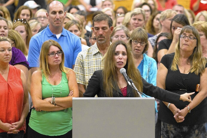 Monica Mora, teachers' advocate for West Orange County Unified Teachers, voices her frustration during a special board meeting regarding asbestos at two Ocean View School District campuses.