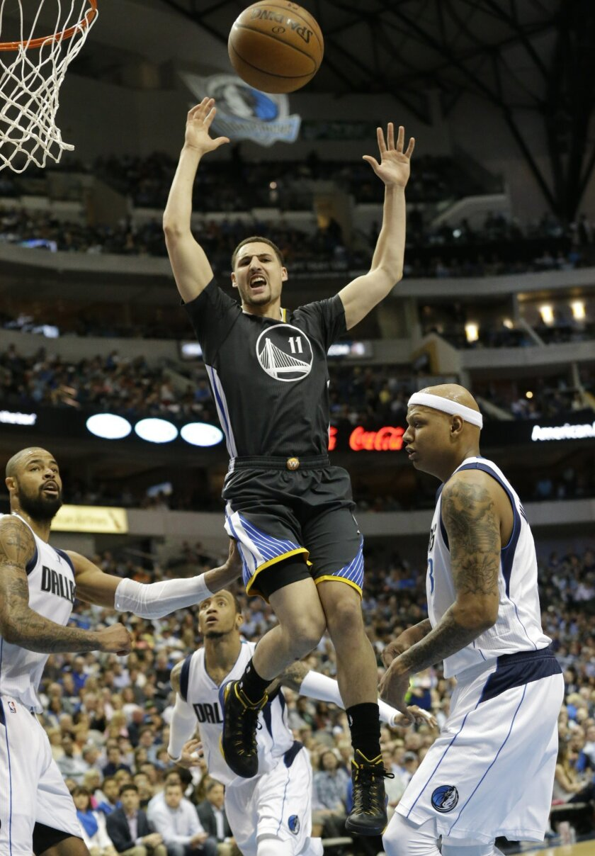 Golden State Warriors guard Klay Thompson (11) looses control of the ball between Dallas Mavericks forward Charlie Villanueva (3) and center Tyson Chandler (6) during the first half of an NBA basketball game, Saturday, April 4, 2015, in Dallas. (AP Photo/LM Otero)