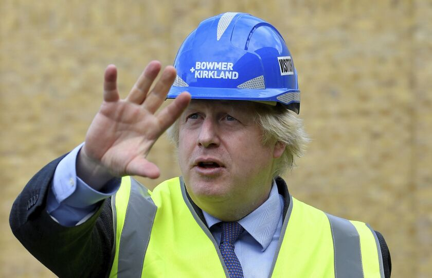 Britain's Prime Minister Boris Johnson visits the construction site of Ealing Fields High School in west London on Monday.