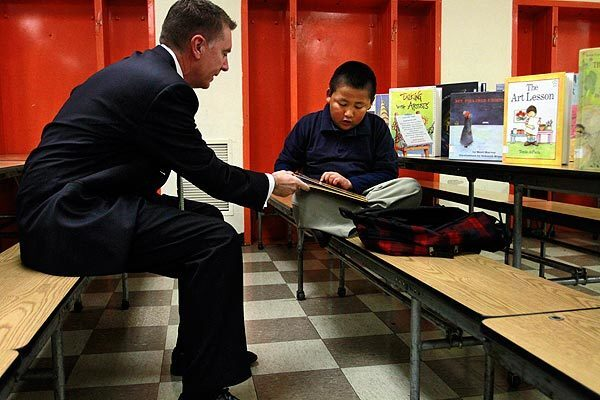 Los Angeles Unified School District Supt. John Deasy chats about a book that David Paredes is reading at Figueroa Street Elementary School in South L.A.
