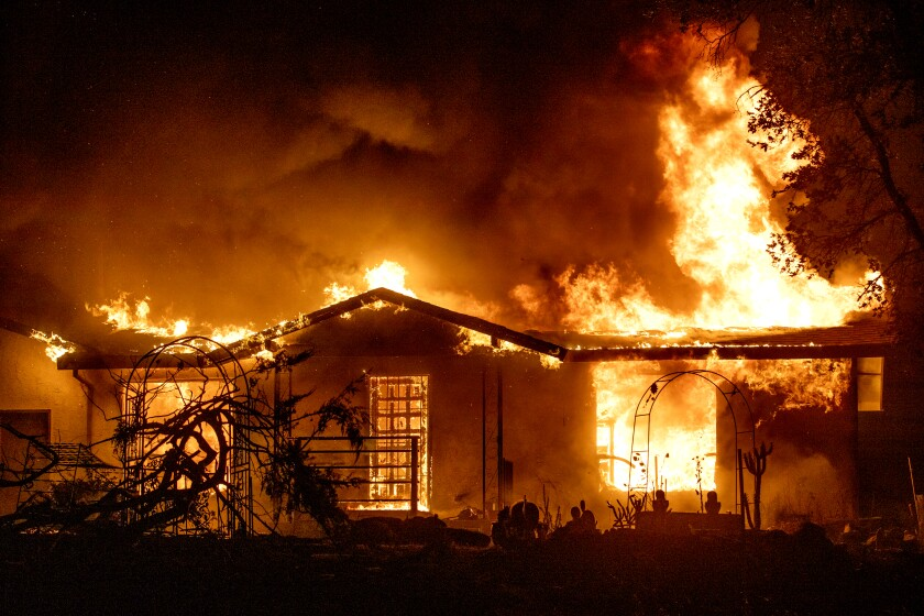 A house burns during the Zogg fire