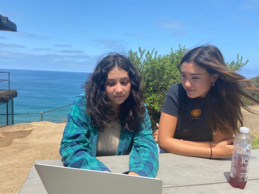 La Jolla High students Priscilla Rayon and Crescent Norman do online research as part of the Social Media Justice League.