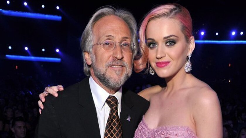 Neil Portnow and singer Katy Perry may see eye to eye. He heads the Recording Academy, under whose auspices the Grammy Awards are presented. She's a three-time nominee this year, who will perform during Sunday's Grammys telecast.
