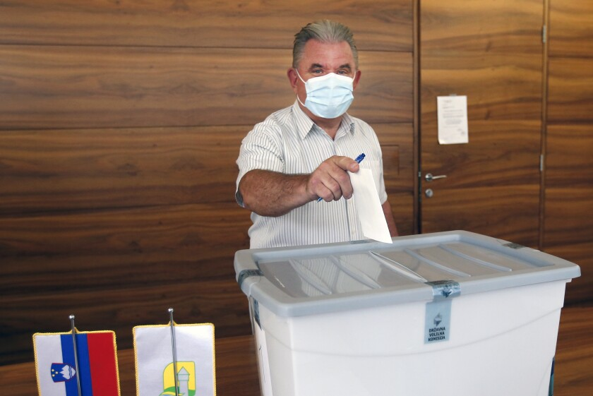 Andrej Vizjak, Slovenia's minister for environment casts his ballot at a polling station in Brezice, Slovenia, Sunday, July 11, 2021. Slovenians voted in a referendum on changes to the country's waters management law that is seen as a test for the government of right-wing Prime Minister Janez Jansa. Jansa's government approved the amendments in March but ecologists have pushed through the referendum saying they threaten the environment by paving the way for construction by the sea, rivers and lakes. (AP Photo)