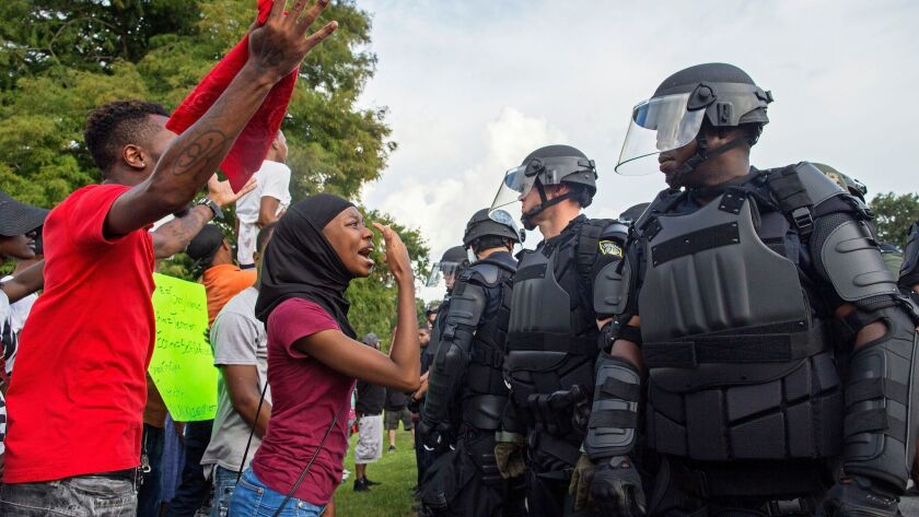 Protesters and police face off in front of Baton Rouge Police Department headquarters on July 9, 2016.