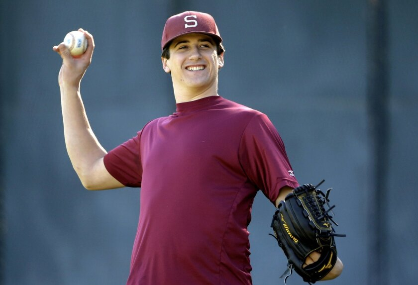 FILE - In this Jan. 13, 2015, file photo Stanford pitcher Cal Quantrill throws during a workout in Stanford, Calif. Stanford ace and projected first-round draft pick Cal Quantrill just hit the one-year mark from his Tommy John elbow surgery and hopes to be facing live hitting within a couple of weeks and perhaps get into games sometime later next month. The most encouraging sign that his comeback is on track: The junior right-hander is pain free after each bullpen he throws. (AP Photo/Marcio Jose Sanchez, File)