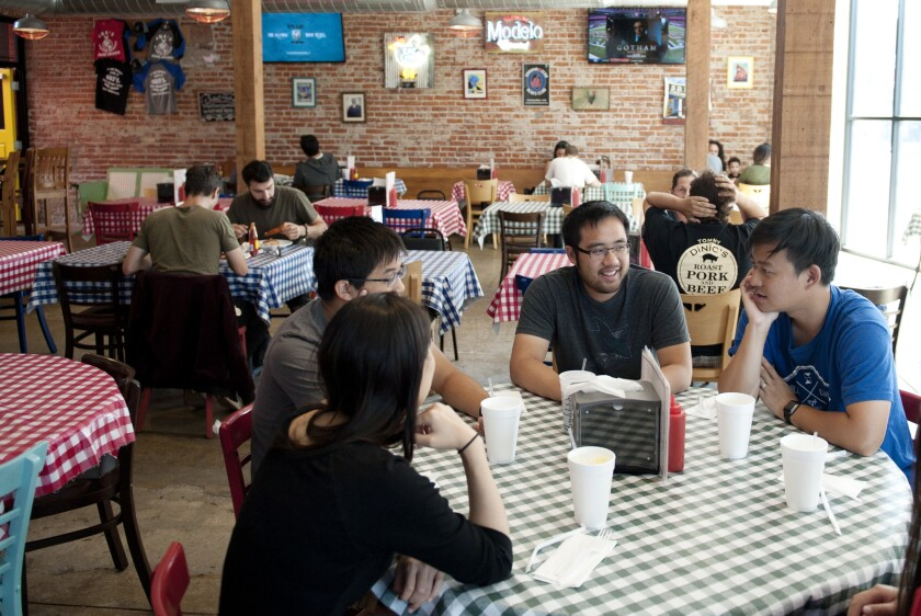 Gus's Fried Chicken, a branch of the Mason, Tenn., original in Arlington Heights, attracts a mixed crowd and it's nearly always packed.