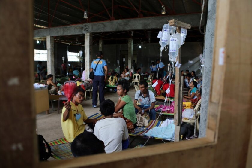 Patients in a hospital in the Philippines after an outbreak of the intestinal illness cholera.