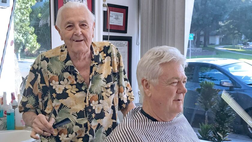 After decades in Glendale, barber Ernie Lind cut the hair of his final customer--also his first--his