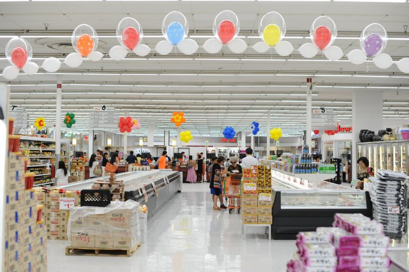 Zion Market's new location on Clairemont Mesa Boulevard is three times larger than the old one, and features 39 subtenants, ranging from restaurants to jewelry stores.