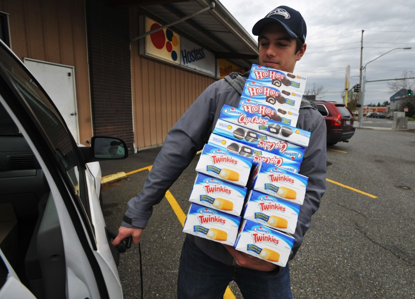 Andy Wagar loads Twinkies, Ho-Hos and Cup Cakes into a van outside the Wonder/Hostess Bakery Thrift Shop in Bellingham, Wash., after Hostess Brands Inc. said it would shut down.