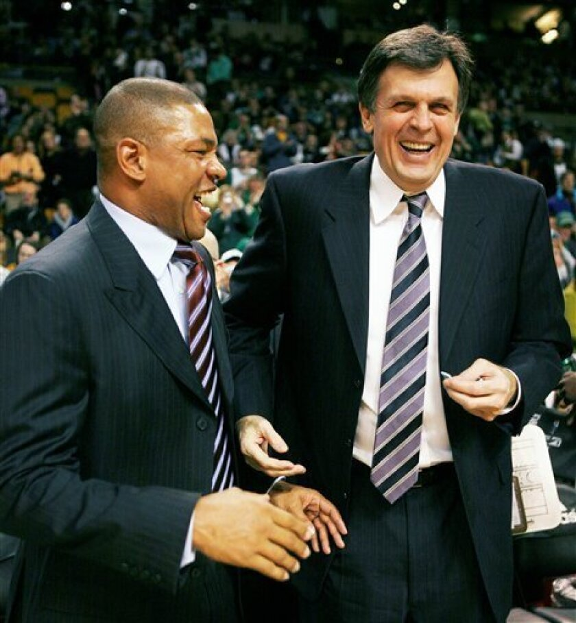 Boston Celtics head coach Doc Rivers, left, jokes with Minnesota Timberwolves head coach and former Celtics player Kevin McHale before the start of an NBA basketball game between their teams, Sunday, Feb. 1, 2009, in Boston. (AP Photo/Michael Dwyer)