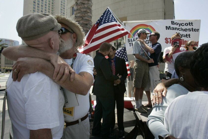 <p>  Yesterday's &#8220;Kiss-in for Equality&#8221; downtown drew dozens of gay-rights supporters.  <em>   &#8201; John Gibbins / Union-Tribune  </em> </p>