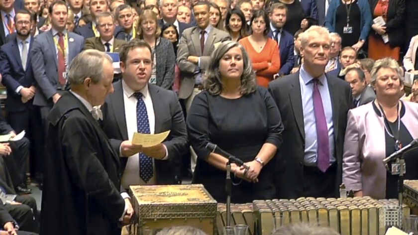 MPs return their results in the House of Commons after a vote on a motion insisting a deal with the