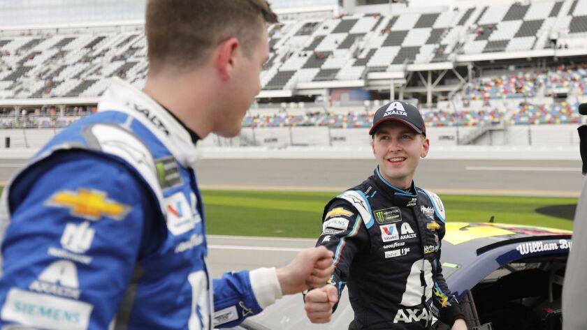 Alex Bowman, left, congratulates Daytona 500 auto race pole winner William Byron, right, after their