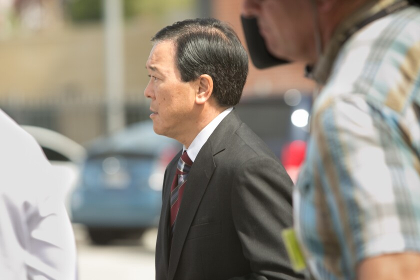 Former Los Angeles County Undersheriff Paul Tanaka leaves the downtown federal courthouse earlier this year after a jury convicted him on conspiracy and obstruction of justice charges.