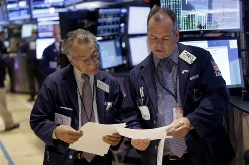 In this Tuesday, Sept. 3, 2013, photo, traders work on the floor at the New York Stock Exchange in New York. Stock futures were mixed Wednesday, Sept. 4, 2013, with the U.S. moving closer to a military confrontation in Syria (AP Photo/Seth Wenig)
