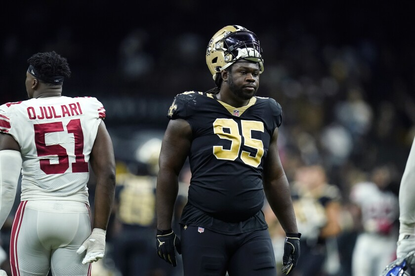 New Orleans Saints defensive tackle Ryan Glasgow (95) reacts after losing on overtime ti the New York Giants during an NFL football game in New Orleans, Sunday, Oct. 3, 2021. The Giants won 27-21. (AP Photo/Brett Duke)