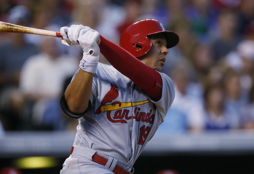St. Louis Cardinals' Jon Jay follows the flight of his solo home run off Colorado Rockies starting pitcher David Hale in the sixth inning of a baseball game Monday, June 8, 2015, in Denver. (AP Photo/David Zalubowski)