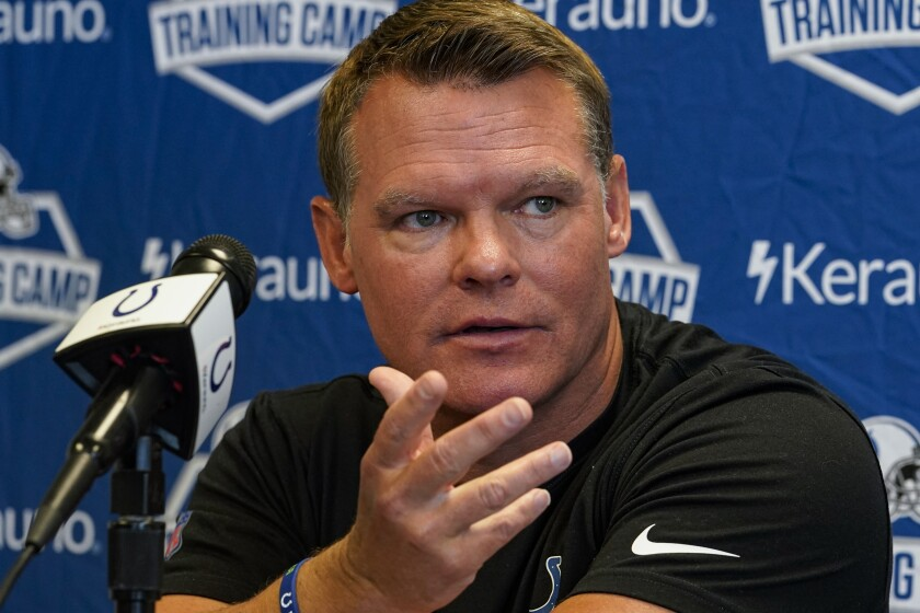 Indianapolis Colts general manager Chris Ballard announces that head coach Frank Reich has tested positive for COVID-19 as the NFL team's football opens training camp in Indianapolis, Monday, July 26, 2021. Reich, who is fully vaccinated, has no symptoms. (AP Photo/Michael Conroy)