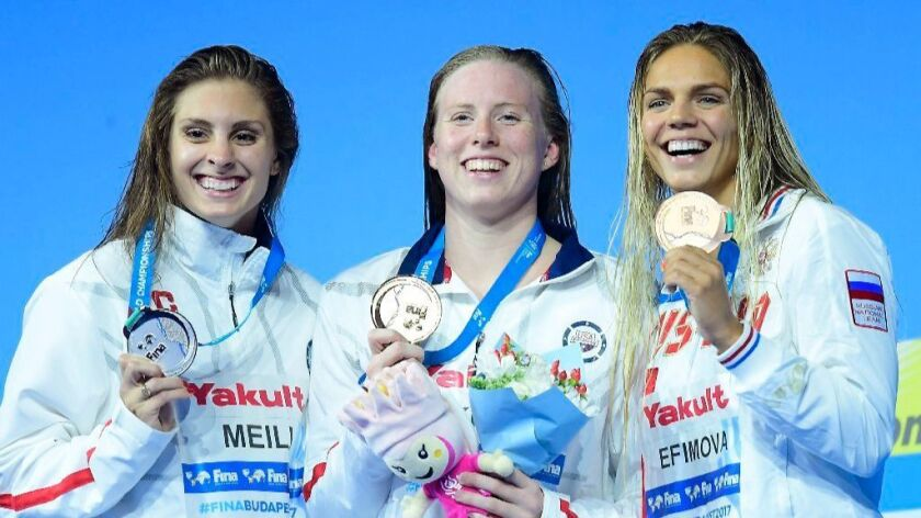 Silver medalist Katie Meili of the United States, gold medalist Lilly King of the United States and
